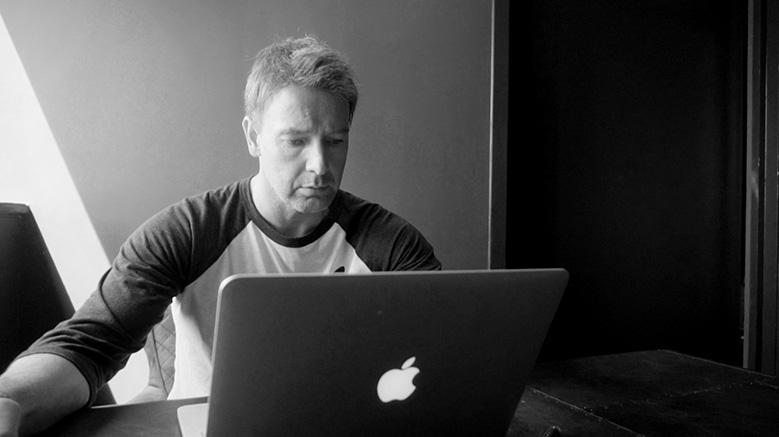 Simon Watson at desk